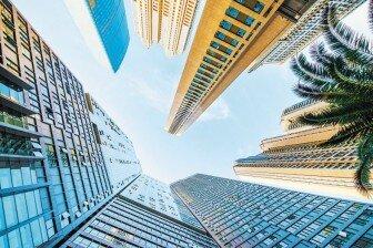 房企前8月业绩亮眼销售向好推动地产股走强